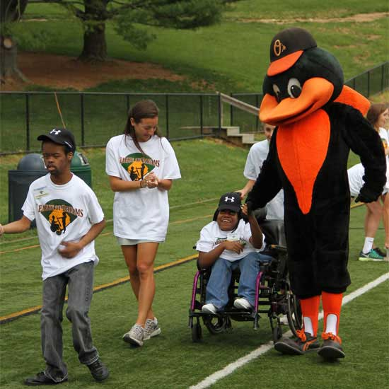 League of Dreams kids with school bird mascot
